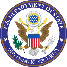 """U.S. Department of State Diplomatic Security"" seal"