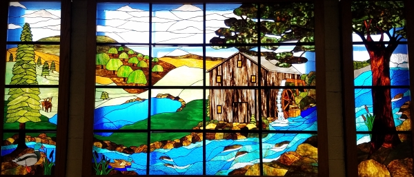 A photo of Living in Harmony with Nature: the second floor stained glass mural in Farrall Hall.
