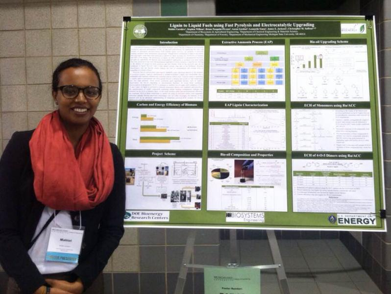 Mahlet Garedew standing by her research poster
