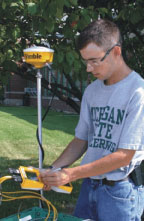 Photo of a Technology Systems Management student working with GPS data acquisition equipment