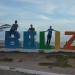 Picture of senior design team next to Belize sign.