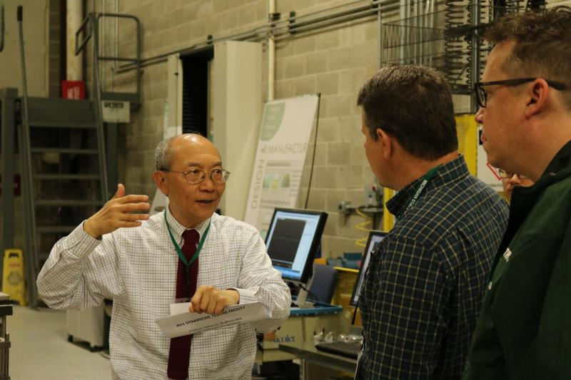 Dashin Liu, professor of mechanical engineering, discusses impact resistance with industry representatives at Road 2 Composites.