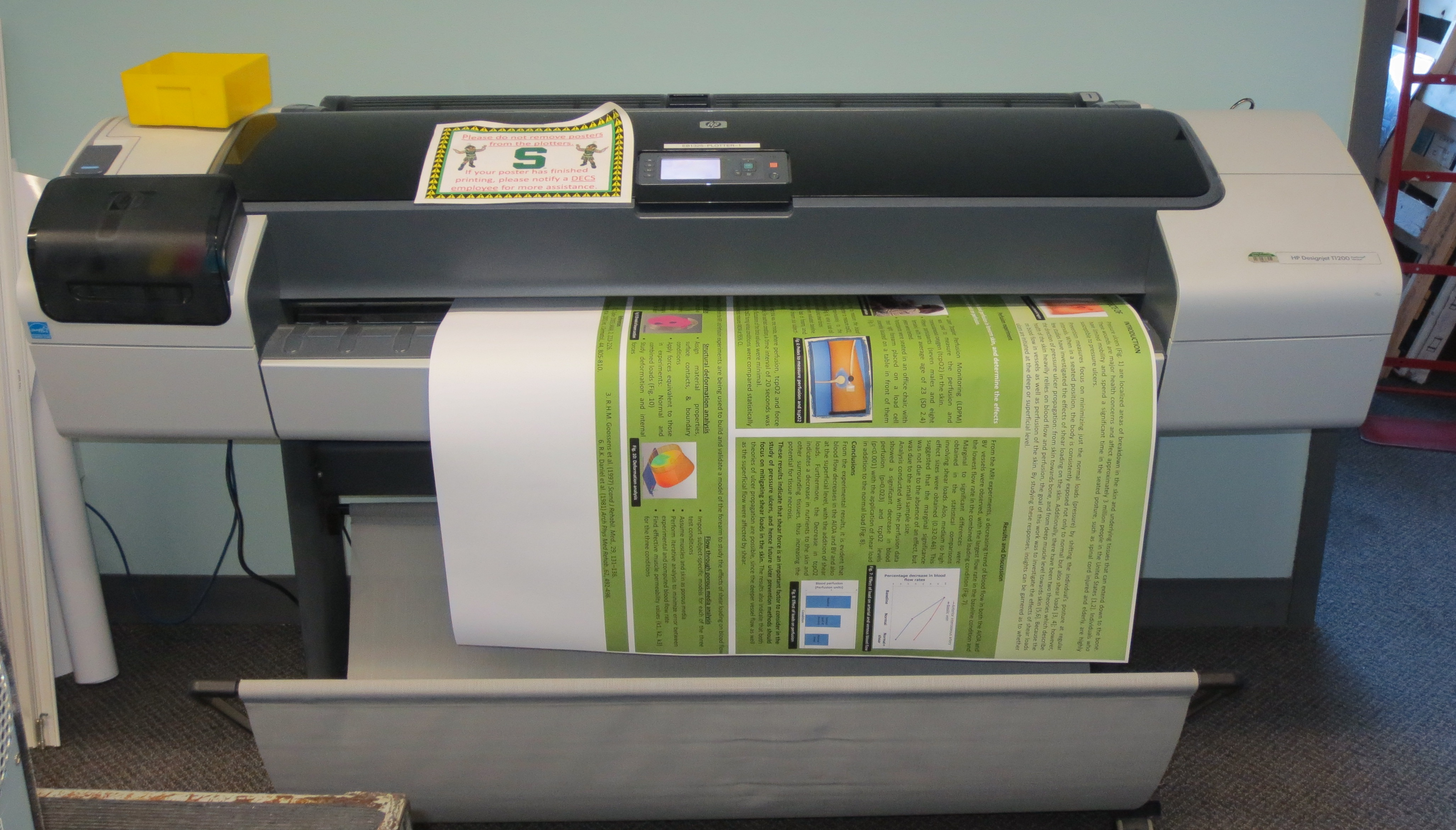Photo of a person printing a poster with the plotter