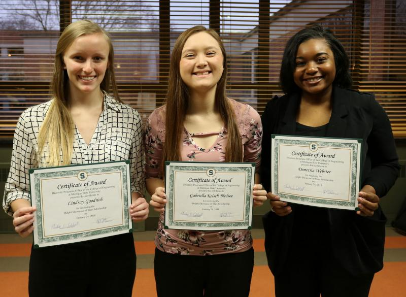Lindsay Goodrich, Gabriella Kelsch Bledsoe and Demetria Webster holding award certificates. Photo by Patricia Mroczek.