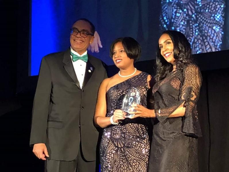 "Stephanie Luster-Teasley (center) received an Innovation Award at the 2018 Black Engineer of the Year ceremonies in Washington, D.C. ""Through my experiences in MSU's Engineering program, I learned how to be an engineering citizen,"" she said. She received a master's and PhD degree in civil engineering at MSU."