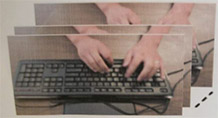 Image of hands on a computer keyboard