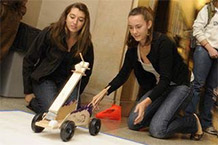 Two students testing their robot