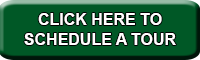 "Green rounded rectangle with the words ""Click here to schedule a tour"""