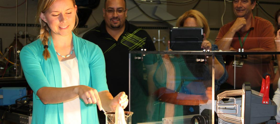RET Teachers learn from a MSU professor during a lab experience