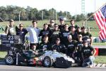 Members of the racing team pose for a picture.