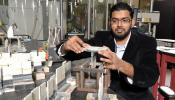 Mahmood Haq, an assistant professor in civil and structural engineering at Michigan State University, inspects structural joints after experimental impact testing. Photo Credit: Michigan State University's Composite Vehicle Research Center