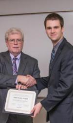 Josh Drost (right) receiving an award from Dr. Tom Wolff