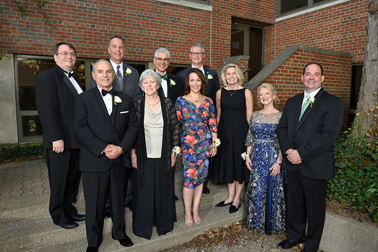 The 2019 Alumni Award winners are (l to r) Front row: Larry Fleis, Karen Newman, Kim Smith, Kathy Fish, Penny Wirsing, Scott Piggott.  Back row: Dean Leo Kempel, Kevin Corfixen, Farshad Fotouhi, Dave Foulke.