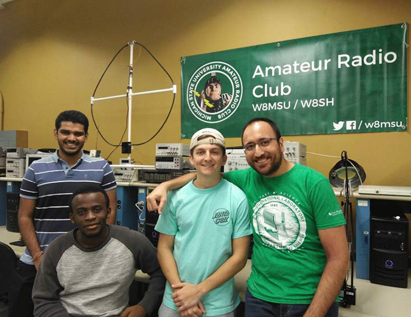 Helping MSU's Amateur Radio Club celebrate its 100th anniversary are Varun Venkatrao (KE8LKD), Nicolau Esteves (KE8LKE), Stephen  Pietras (KE8LAK), and Volkan Yildirim (KE8KYB).