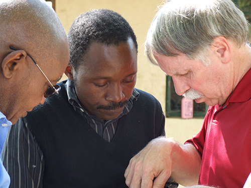 Erik Goodman (right) continues to assist teachers and students in northern Tanzania using Spartan Engineering skills to enable Internet access through solar power.