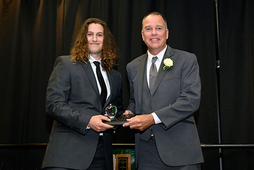 MSU student Samuel Daniels, a senior in chemical engineering presented Kevin Corfixen the 2019 Green Apple Award.