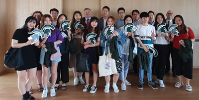 "There was a ""Go Green, Go White"" spirit at the signing ceremony in Korea."