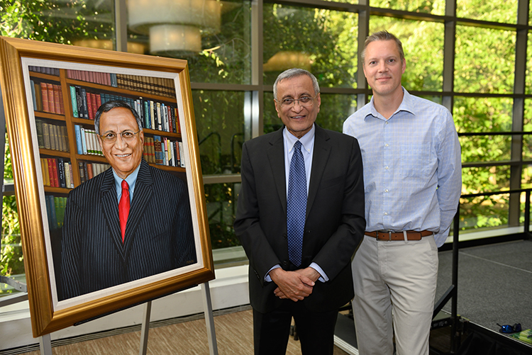 A portrait honoring Satish Udpa, eighth dean of the college, was created by artist Brian Kirschensteiner (right).