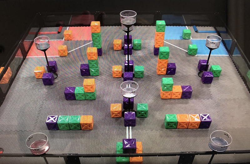 This year's game, VEX Turning Point, uses 66 colorful cubes on a Tower Takeover Field.