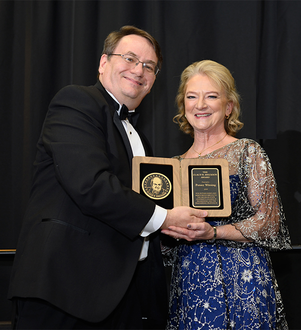 Dean Leo Kempel presents the 2019 Claud R. Erickson Distinguished Alumni Award to SWE National President Penny Wirsing ('83).