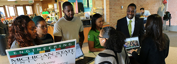Students (from left) Randi Dortch, Jezreel Wallace, Demarcus Gregory, and Shayna Evans, along with Diversity Programs Director Kyle Foster, chatted with Kasey Coleman and Kaleigh Jaeger-Hale at the Give Green Day table in the Engineering lobby on Nov. 27. The DPO endowed fund received $3,680 on Give Green Day.