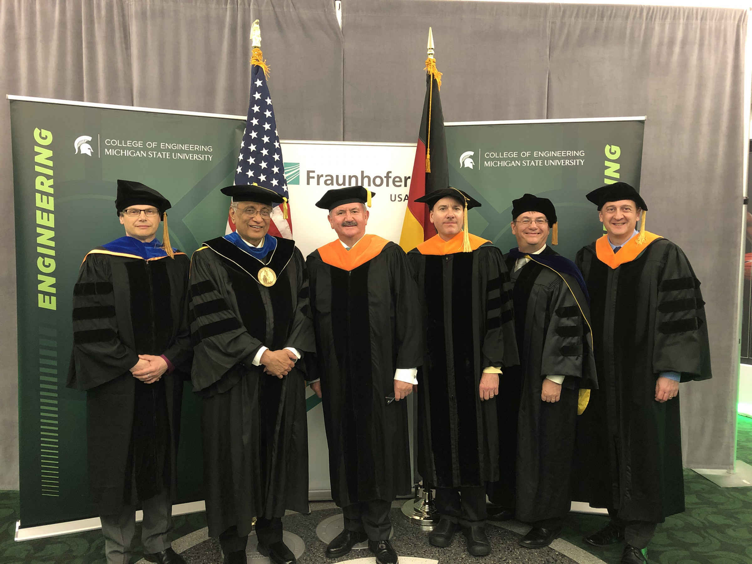 Celebrating the 15-year history of Fraunhofer USA and MSU were (from left) Thomas Schuelke, Acting MSU President Satish Udpa, President of Fraunhofer-Gesellschaft Reimund Neugebauer, John Albrecht, Dean Leo Kempel, and John Papapolymerou, prior to Commencement on May 3.