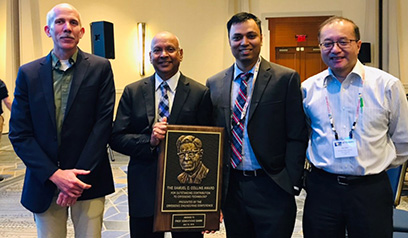 MSU Cryogenics Initiative Director Venkatarao Ganni (second from left) received the 2019 Samuel C. Collins Award. From left are Senior Cryogenic Process Engineer Peter Knudsen, Ganni, Cryogenic Process Engineer Nusair Hasan, and FRIB Accelerator Systems Division Director Jie Wei.