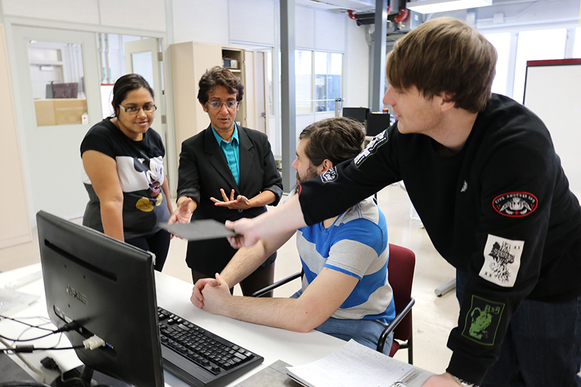 Swathi Muthyala, a PhD student in electrical engineering, Lalita Udpa, Ciaron Nathan Hamilton, a senior in computer engineering, and Paul Henry Probst, a senior in electrical engineering, work on nondestructive testing research at MSU.