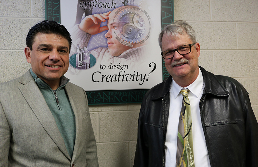 James Klausner, professor and chair of the Department of Mechanical Engineering, and Thomas Wielenga ('78) pose near a creativity poster to help announce the Wielenga Creative Engineering Endowed Professorship.