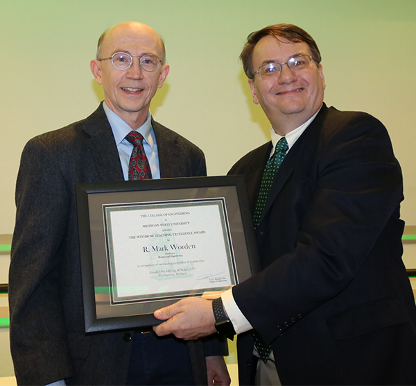 R. Mark Worden received his Teaching Excellence Award from Dean Leo Kempel.