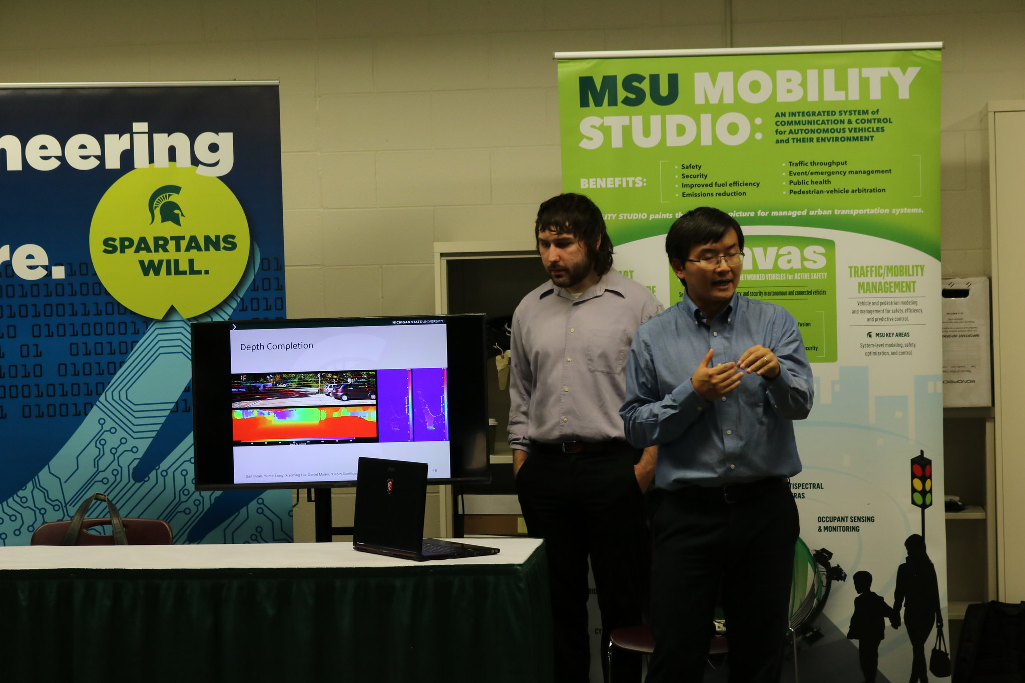Xiaoming Liu (right) is among the Spartan Engineers who help showcase research during special events.