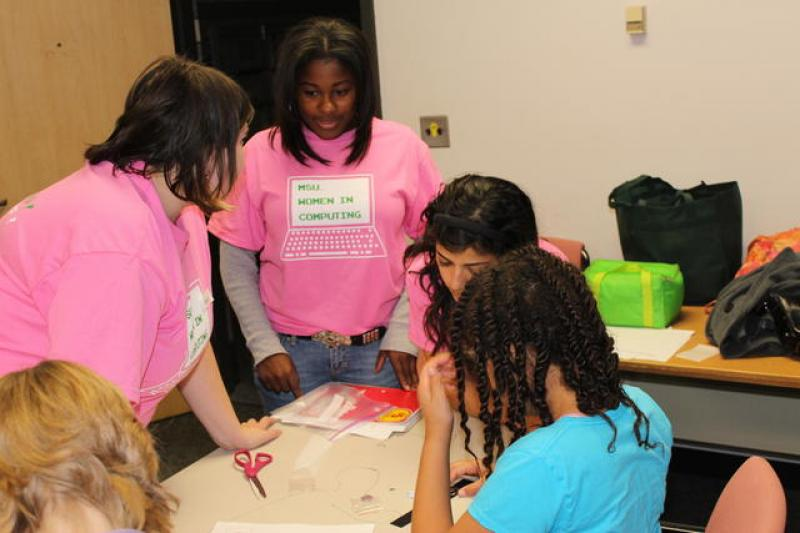 Photo of Women and girls around a table at WOW That's Engineering program